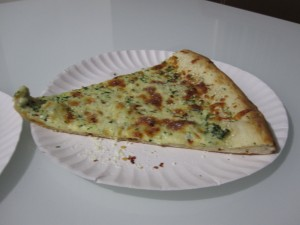 This is a slice of the famous Spinach Pizza